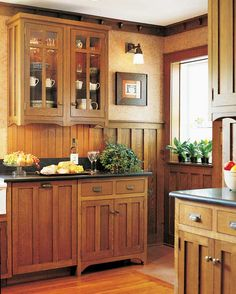 Mission/Craftsman style. Love the look of this kitchen. love the drawer pulls and the darker countertops. easy to do with my oak cabinets