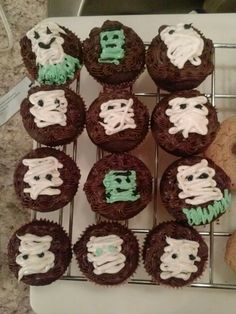 Reeses peanut buttercup filling, choc cupcake with a mini kit kat under the cream cheese mummy frosting....Frankenstein also easy for Halloween