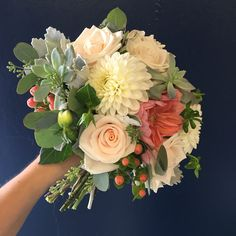 Dahlias, roses, succulents and berries in this coral and cream woodsy bridal bouquet Flower Bomb, Dahlias, Bridal Bouquets, Succulents, Berries, Floral Wreath, Roses, Coral, Wreaths