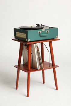 The record players at school looked like this one.  They were kept in the library and checked out by the classroom teacher when needed.