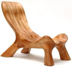 Curve Chair: Handcrafted by Jess and Nicolas Meyer in Roberts Creek, BC. Made of solid western maplewood, laminated and finished in hand rubbed linseed oil. Each chair is individually sculpted from clay and then carved by hand. No two chairs are exactly the same.