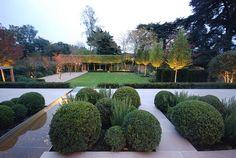 Formal Structural Garden | Formal structural garden lit up at night | Charlotte Rowe Garden Design