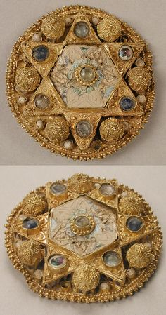 Brooch, 970–1030, Ottonian (probably northern Italy), gGold with pearls, glass, and cloisonné enamel; Overall 1 1/2 in. (3.8 cm). This brooch in the shape of a star is decorated with miniature architectural forms constructed of fine gold filigree and granulation. It is the kind of costume adornment worn by high-ranking members of the Ottonian court.