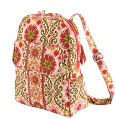 Symphony in hue is my favorite Vera Bradley pattern and I use backpack purses most of the time in my busy life. The purse has two side pockets, a large front and back pocket - one with a zipper and one with a magnetic catch.  The magnetic catch works really well, much to my surprise.  On the inside this bag has two