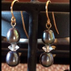 Tahitian South Sea Pearl Dangle Earrings 14k Gold black Tahitian Pearl South Sea Pearl Earrings with faceted Swarovsky Crystal Beads with 14k gold wire Earrings. They are a lovely addition to any wardrobe. Dangle length 2cm. Please inquire if you'd like a matching pendant customized. LA Custom Designs Jewelry Earrings