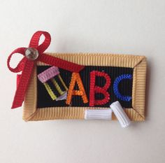 A new school year is upon us! What a cute hair clip to an exciting first day of school!! Manufactured by Three Bears Bows