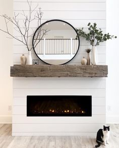 Farmhouse fireplace with floor to ceiling shiplap and rustic mantle. modern round mirror and eucalyptus finish the vignette. Mirror Over Fireplace, Fireplace Mirror, Fireplace Mantle, Farmhouse Fireplace, Bedroom Fireplace, Mantel Shelf, Fireplace Design, Modern Mantle, Rustic Mantle Decor