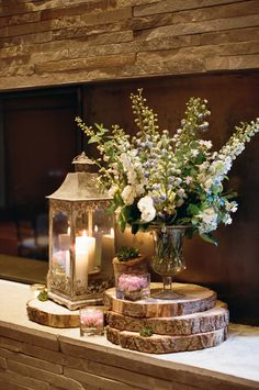 rustic wedding lanterns on the tree slice-with-wild-flower Lantern Centerpiece Wedding, Wedding Lanterns, Rustic Wedding Centerpieces, Centerpiece Ideas, Rustic Lanterns, Tree Stump Centerpiece, Centrepieces, Christmas Centerpieces, Autumn Wedding Decorations