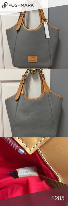 """Dooney & Bourke Penelope Gray Tote Brand new with tags. 10 x 9 3/4 x 6 with adjustable handles with maximum 10 3/4"""" strap drop.  Prepped leather.  1 zip pocket, 3 open pockets.  Key hook.  Has NOT been registered.  Tan leather trim. Silver palladium hardware. Oversized buckles and grommets.  4 metal feet.  This is a new style for Dooney. Dooney & Bourke Bags Totes"""