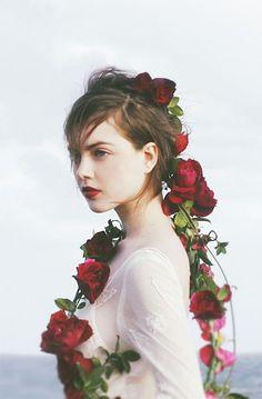 Miranda: Look Inspiration. Red Wine Rose Lei via The LANE's Velvet Heart Editorial.