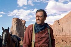 The best John Wayne movies, ranked by fans and critics. if you love John Wayne movies, then get to voting on your favorites! John Wayne Son, John Wayne Movies, Western Film, Western Movies, John Wayne Airport, The Searchers, John Ford, Famous Movies, Movie Costumes