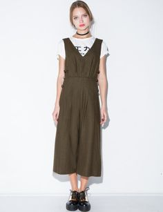 J.O.A. Wool blend  wide leg jumpsuit with buckled side closure and pleated detailing.