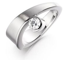 A beautiful and truly unique platinum single stone round brilliant cut diamond ring. Jewellery Designer of the Year - multiple award winner. Catalogue Number 260650