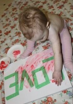 Do this for each baby you have!  1 Tape love on a canvas 2 have baby paint over it 3 peel the tape off
