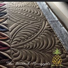 One last closeup of Final Four before I reveal the whole quilt. Top border design using the #20 and #15 QP Curve Templates - quilted pineapple