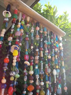Rainbow Suncatcher with natural driftwood and colorful beads