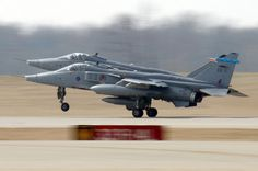 Two British Royal Air Force SEPECAT Jaguar GR.3 fighter aircraft (s/n XZ114, XZ117) from No.6 Squadron, RAF Coltishall, East Anglia (UK), take off from MidAmerica St. Louis Airport, Illinois (USA), on 7 March 2006. The Jaguars headed back to the UK after participating in Exercise Red Flag at Nellis Air Force Base, Nevada (USA).
