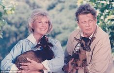 Actress Doris Day and author Cleveland Amory, both activists for animals, holding baby goats
