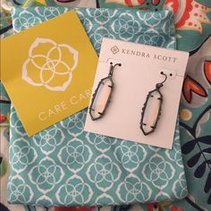 Kendra Scott Fran earrings Color is iridescent opalite. This size in this color is extremely hard to find which is why the price is higher than the original, plus I'm trying to make most of my money back! Some like this size better because it is lighter on their ears. Open to offers and trades! Kendra Scott Jewelry Earrings