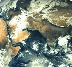 ISRO's Mars Orbiter has beamed back the first set of pictures of the Earth, capturing the Indian subcontinent and parts of Africa. The first image was taken on November 19 at around 1:50 PM from a height of almost 70,000 km above earth and has a spatial resolution of 3.5 km.  The severe cyclonic storm 'Helen' hurtling towards Andhra Pradesh coast is clearly visible in the first image.