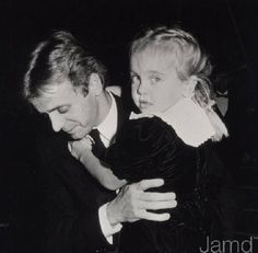 """Mikhail Baryshnikov with his daughter Shura at the Premiere Party for the film """"White Nights"""", November 09, 1985. Photo by Ron Galella"""