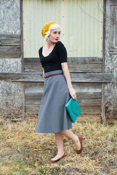 awesome checked skirt, golden tam, teal clutch, brown ballet flats, black top, sweet little belt.  So much to love!