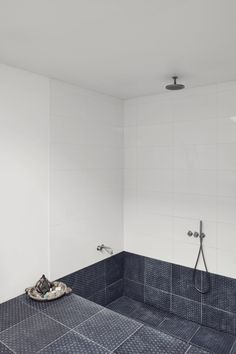 The recessed bath and shower makes the space feel like a private spa.