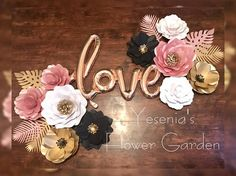 Rose Gold Love Paper Flower set 2 - Medium Paper Flowers (between 12-14) 8 - Small Paper Flowers (between 8-10) Set of Tropical leafs (5) Rose Gold, White, Black and Gold. **** the new Love balloon is a different shade of gold rose shown on this picture** PLEASE INDICATE YOUR