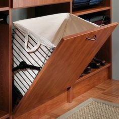Closet Accessories - A tilt-out hamper is perfect for storing dirty clothes and keeping colored clothes separate from whites.
