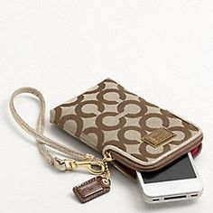 the best invention yet! i don't like big ole purses..this fits my debit cards/license and phone! got one similar to this at coach today for $30! booyaa!