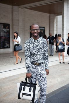 Men carrying womens bags, especially CELINE! They Are Wearing: New York Fashion Week Spring 2013