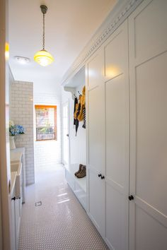 Consider styling your laundry in white tiles from the walls to the floor for a European mudroom look. Design Mark Stehbens Photography Shaun Murray Statement tiles in white laundry/mudroom Laundry Room Storage, Laundry Room Design, Laundry In Bathroom, Laundry Nook, Laundry Cabinets, Garage Storage, Storage Shelves, Hallway Cupboards, Hall Cupboard