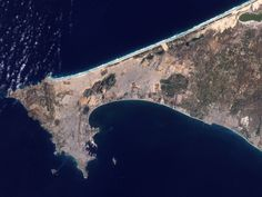The long, green line in the northwest is the runway of Senegal's airport in Dakar. - Visible Earth/NASA