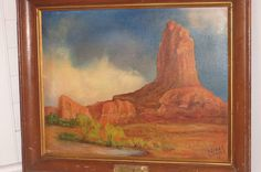 Here is a very nice vintage oil on canvas painting of a Southwest desert scene.It measures 19 1/2 x 23 1/2 with the frame. The frame has a brass/metal placard that says :  Hostine Bah.  By C. Lake Evans  Gen. 1:26 ( shown below)  (Then God said, Let us make mankind in our image, in our likeness, so that they may rule over the fish in the sea and the birds in the sky, over the livestock and all the wild animals, and over all the creatures that move along the ground.)  The painti...