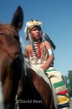 Crow boy on Horseback, photograph by David Neel, Native American photographer