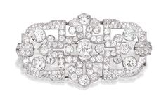 PLATINUM AND DIAMOND BROOCH, MARZO, PARIS Of openwork design, centered by an old European-cut diamond weighing approximately 1.25 carats, accented by numerous smaller old European, old mine and rose-cut diamonds weighing approximately 9.50 carats, signed Marzo, Paris; circa 1930. With signed and fitted box.