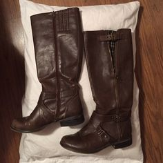 Riding Boots Brown leather riding boots with strap around the ankle and a second zipper on the outside of leg with brown plaid material showing through Guess Shoes Winter & Rain Boots