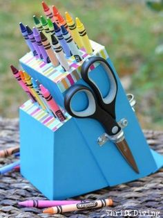 Take an old knife holder from a thrift store, and with the help of a drill, turn it into a crayon holder!