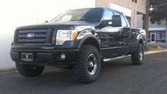 """Ford F150 with 3"""" Readylift Leveling Kit 34"""" Kelly Safari M/T Tires on Black Rhino Wheels"""