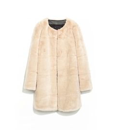 This furry coat from Zara will keep you warm in the colder months