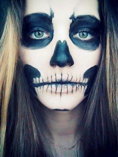 Skull face paint looks sexy on her
