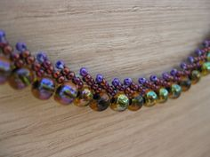 St. Petersburg stitch.  This classic Russian stitch leaves me breathless. Czech and Japanese beads give this piece a life of its own. Lovely purples, great for a fancy evening out.