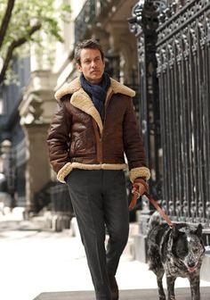 Shop this look on Lookastic:  http://lookastic.com/men/looks/charcoal-dress-pants-navy-cotton-scarf-brown-shearling-jacket/5812  — Charcoal Dress Pants  — Navy Cotton Scarf  — Brown Shearling Jacket