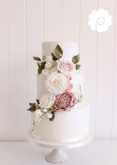 Soft pinks and greens in the florals on this elegant wedding cake are just perfect!