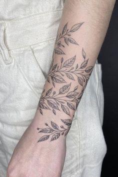 Plant wrist cuff tattoo by Emrah Ozhan - Book with Emrah on the Tattoodo App or find an artist near you! - #leaftattoo #naturetattoo #planttattoo #illustrativetattoo #cufftattoo #wristtattoo #leavestattoo #finelinetattoo #tattooidea #tattooinspo