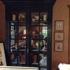 Stunning cabinet filled with family heirlooms pics and art...so great to put this together!!! Sorry the pic does not give it the justice it deserves!!