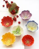 Ceramics - handbuild small dishes by cutting dart in circle shape and then cutting rim to look like petals.
