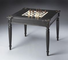 Play a variety of games on this stylish table that is veneered with basswood. The top inset has a game board for chess and checkers. Flip the inset over and it converts to a green felt-lined blackjack table. Remove the insert altogether and the well beneath the inset is a backgammon game board. This table comes with all game pieces, cups, dice and a deck of cards for playing chess, checkers,backgammon,blackjack/card games and cribbage. Four glass holders on each corner.Product Dimensi...