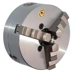What are the different types of work holding devices used to hold a workpiece in a lathe machine? - Quora