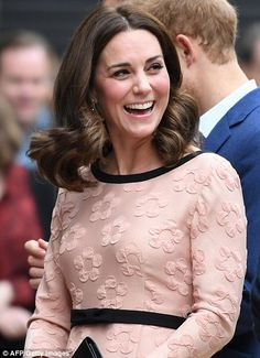 Today, she debuted a glossy and shorter hair 'do that was timeless and flattering...